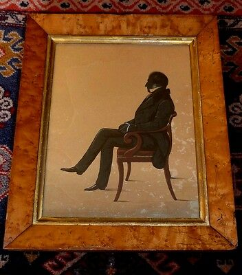 Antique C19th full length silhouette of an elegant gentleman in a maple frame.