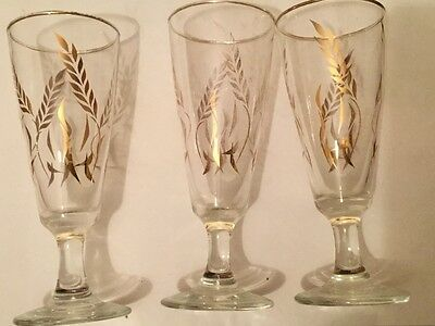3 champagne glasses with gold rim and gold leave pattern