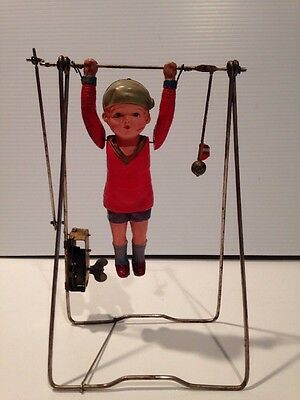 Vintage  Mechanical Acrobat Celluloid Trapeze Wind Up Toy Works