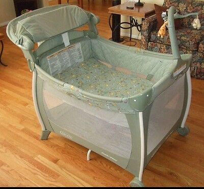 Graco  portable playpen, napper & diaper changing station with musical mobile