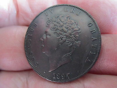 A 1827 King George 1V Halfpenny. A very high grade coin.