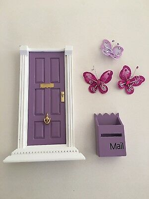 Fairy door with mail box and butterflies