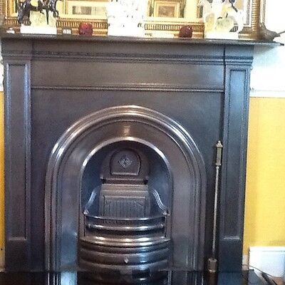 Cast iron fireplace insert surround and polished black granite hearth