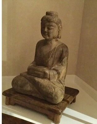 wood budha and stand