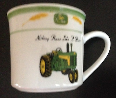 """John Deere coffee cup marketed by Gibson """"nothing runs like a Deere"""""""