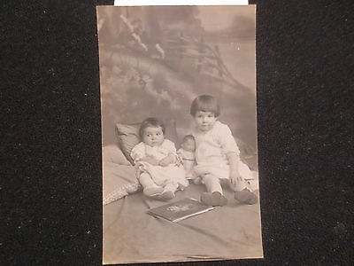 PHOTOGRAPH OF TWO LITTLE GIRLS WITH THEIR PRECIOUS BABY DOLL,RPPC c1910 DOLLS