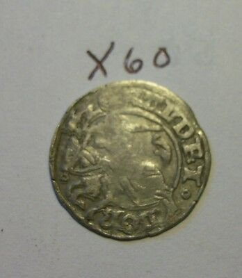 silver medieval coin, man on horse. (X60)