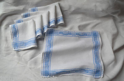 6 antique French cotton and silk blue bordered napkins