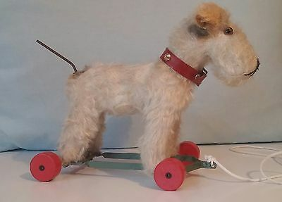 Vintage Fox Terrier Dog Trattler From 30s On Wheels with articulate Tail