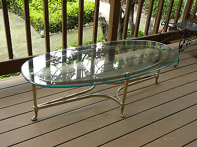Vintage hoof footed brass base tempered beveled glass top oval coffee table EUC