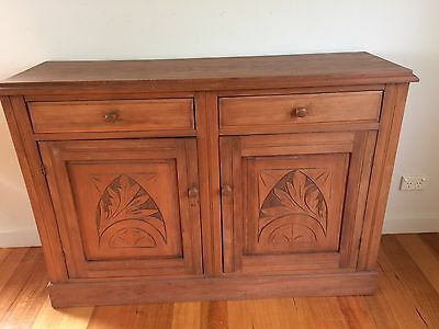 Antique Australian cabinet with carved doors