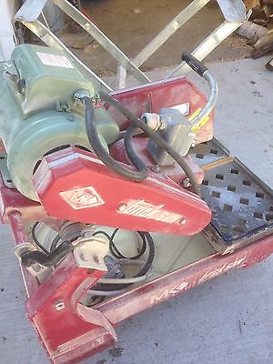 """MK  14"""" brick saw 120/230 volt lightly used with stand owners manual 220 ex cord"""