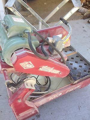 "MK brick 14"" brick saw 120/230 volt lightly used with stand"