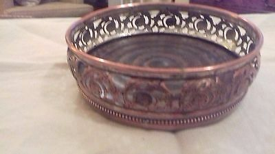 Antique silver plated wine coaster with baize base