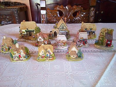 A collection of 11 Lilliput lane lovely cottages/excellent condition/no boxes