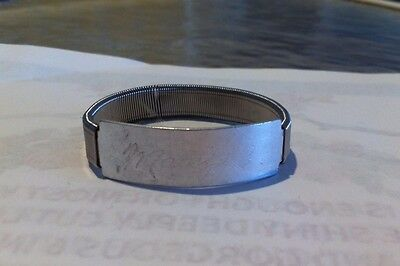 Girl's 50's metal ad bracelet for Weather Bird Shoes,