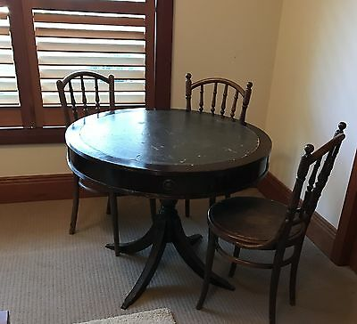 Round timber table with drawers