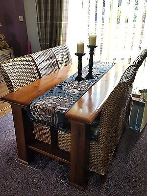 Extending Pine Table and 6 Wicker Chairs