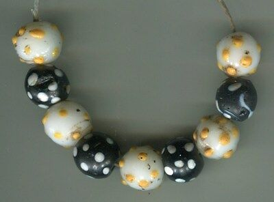 African Trade beads Vintage Venetian glass black skunk and yellow eye beads