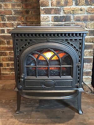 Repurposed cast iron fireplace with electric flame