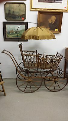 vintage wicker baby buggy/carriage with silk umbrella in fabulous shape for age
