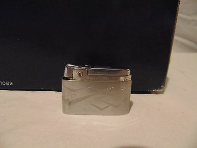 "vintage Schick Lighter silver color USA 2 1/4"" long 1 1/2"" tall"
