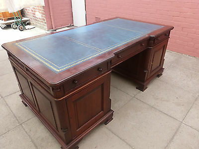 A Large Brown Wood Blue Leather inlayTwin Pedestal Partners Desk