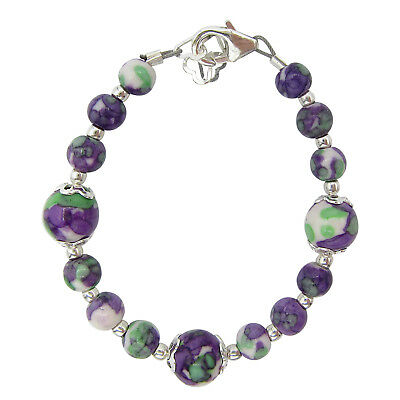 Purple design with some green and silver bracelet