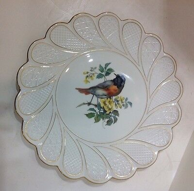 Meissen crossed Swords porcelain charger. hand-painted bird in center. antique.
