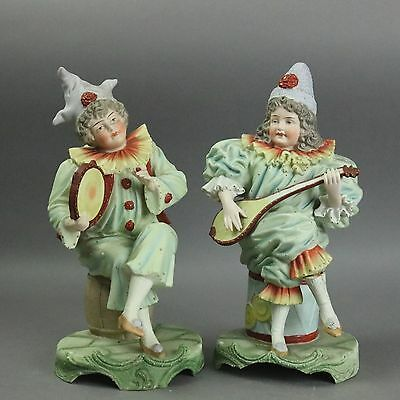 Antique Pair of Chelsea Style Bisque Porcelain Musical Jester Figurines