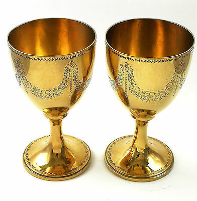 pair of gilt solid silver goblets
