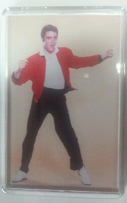 Two Elvis presley  fridge magnets