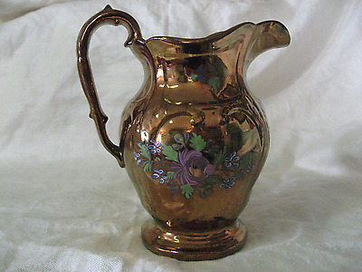 Antique Copper Luster Pitcher with hand painted flowers, 5 and 1/2 inches tall.