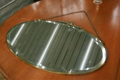 OVAL BEVEL ANTIQUE MIRROR WITH BRASS FINAL, very pretty, in good condition
