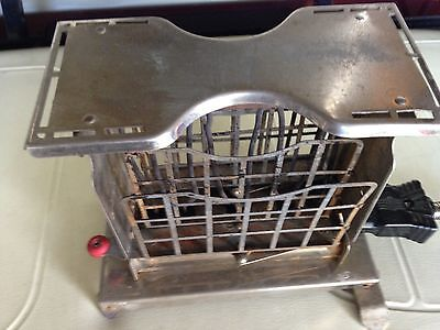 Antique Torrid Push Button Toaster With Swingout Bread Holders