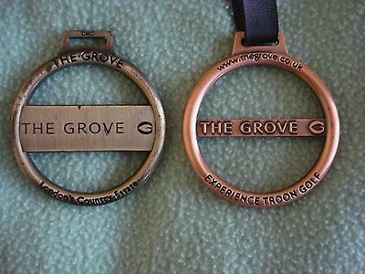 """2x Golf Bag Tags from """"The Grove"""" Golf Club. One mint the other well used."""