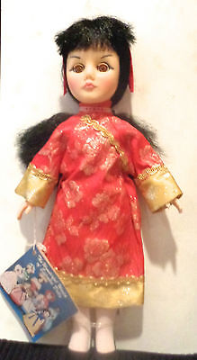 """Effanbee  Chinese  11"""" Doll  Never removed from cardboard liner No box"""