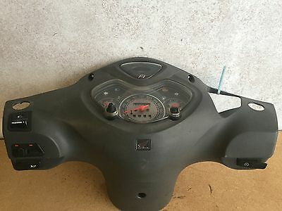 Black 2011 Honda PS PES 125cc clocks with cover and all switches