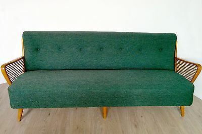 Vintage / Retro mid century button back sofa with rattan arms.