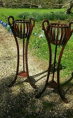 Handsome pair of swan handled antique style plant stands