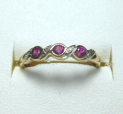 9ct Yellow Gold  ( 3 )  Ruby and ( 4 ) Diamond Ring