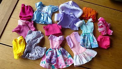 Mixed Collection of dolls clothes unknown makes