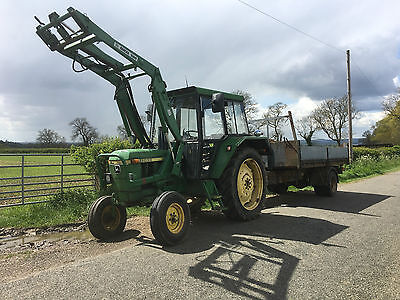 John Deere 2030 Tractor with front loader. comes as a package. trailer, flail