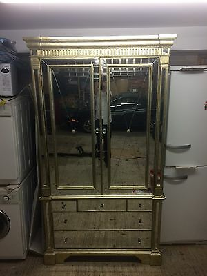 Antiqued gold and mirror glass armoire