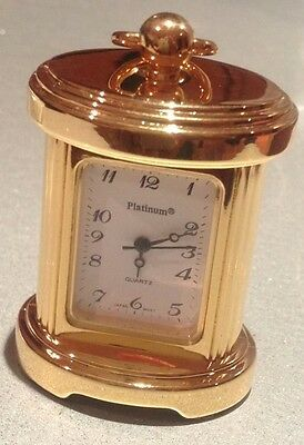 Miniature carriage clock in a gold plated polished finish