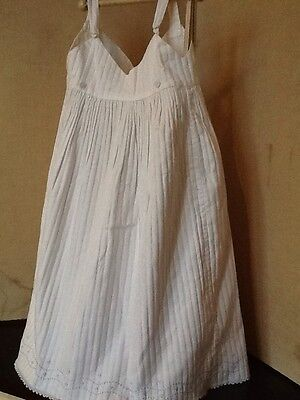 Vintage Child's Pinafore Dress In Embossed White Cotton With Embroidery Detail