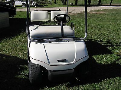 golfcart. Yamaha Petrol G19 and tilt trailer excellant condition.Trailer registe
