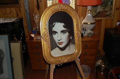 High glamour photograph of Elizabeth Taylor in antique frame.