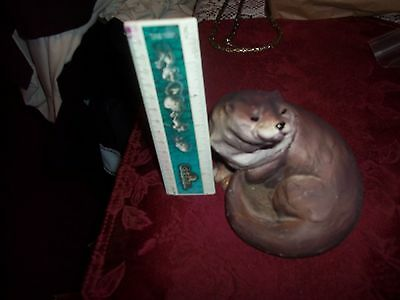 ceramic statue otter or ferret signed ken levoli good condition