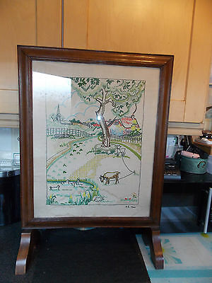 Oak fire screen with embroidery sampler 1946 behind glass 52x74cm